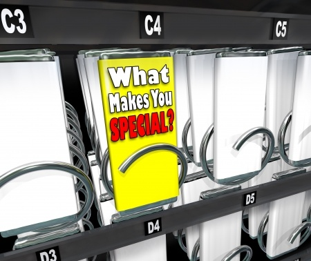 14089606 - one candy bar stands out as different or unique in a snack vending machine, with the label what makes you special? asking what is your unique selling proposition, skill or point to set you apart from the competition