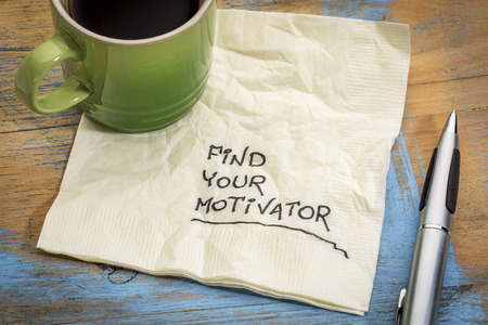 62968347 - find your motivator advice - handwriting on a napkin with a cup of coffee